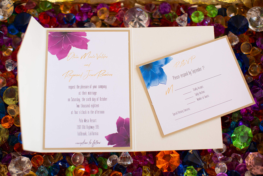 Custom invitation in folder with rsvp in floral design