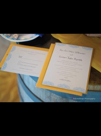 close up of wedding invitation & rsvp