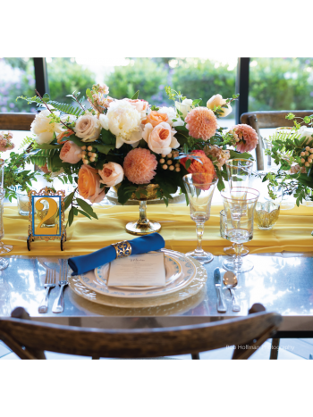 custom menu with table setting and flowers