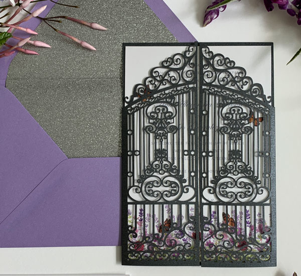 ornate iron work gate laser cut invitation folder in black shimmer with lavender envelope and silver glitter liner