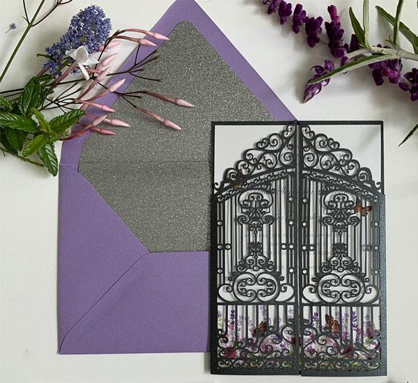 Laser cut invitation folder and lavender envelope with silver glitter liner