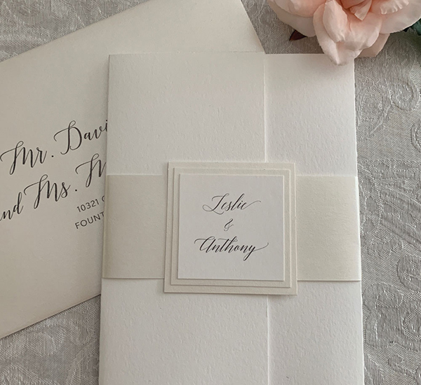 handmade invitation folder with belly band and name plate