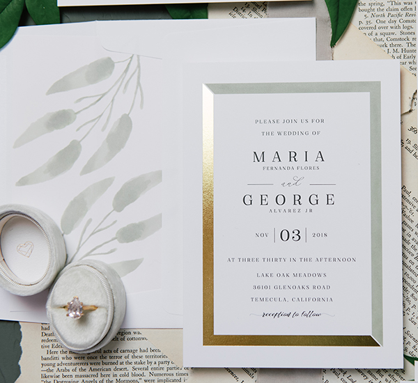 closeup of invitation with gold foil and envelope with coordinating envelope liner