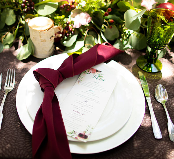 place setting with floral design menu